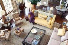 19 a yellow sofa and yellow pillows tie up the different sofas together making them more matching