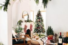 19 cover the archways with evergreens to make the space feel festive and not taking any floorspace