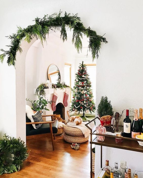 cover the archways with evergreens to make the space feel festive and not taking any floorspace