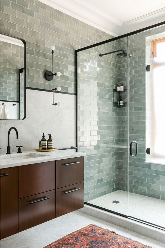 light green tiles in various shades make this bathroom very catchy, interesting and unusual