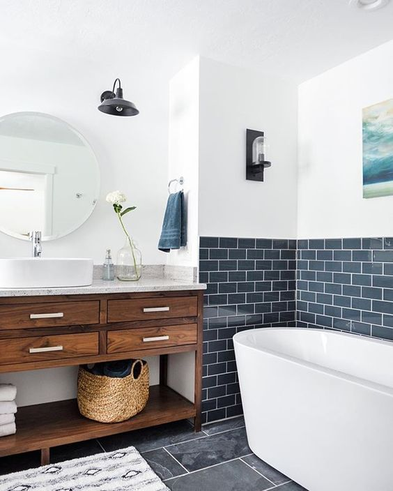 a backsplash of navy subway tiles with white grout is a refreshing and modern idea for a bathroom
