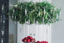 20 a lush hanging Christmas wreath chandelier with silver ornaments doesn't take much space