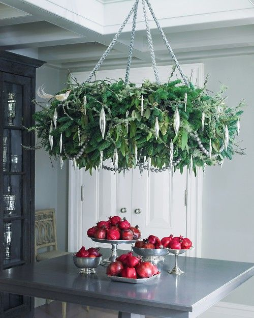 a lush hanging Christmas wreath chandelier with silver ornaments doesn't take much space