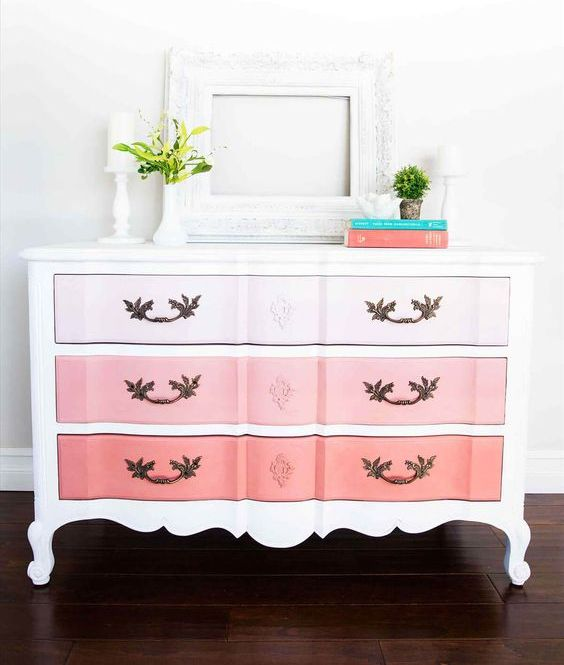 a vintage dresser with an ombre effect, from light pink to coral is a chic color statement
