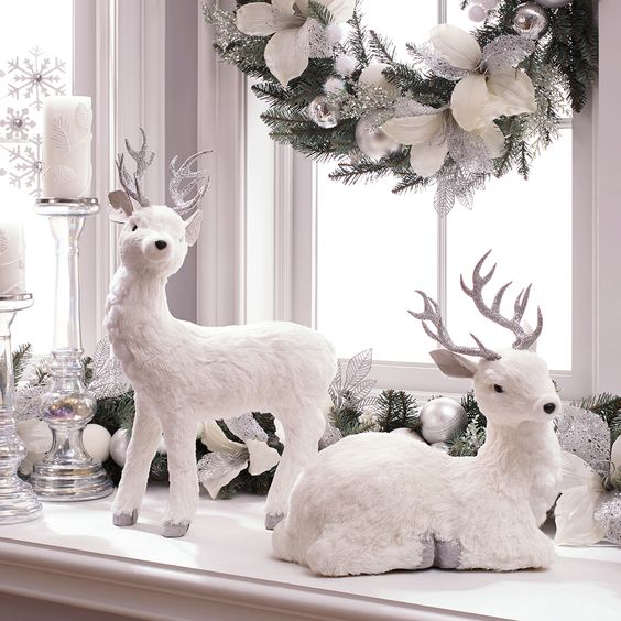 fake white deer, a beautiful fake evergreen wreath with silver and white ornaments and candles