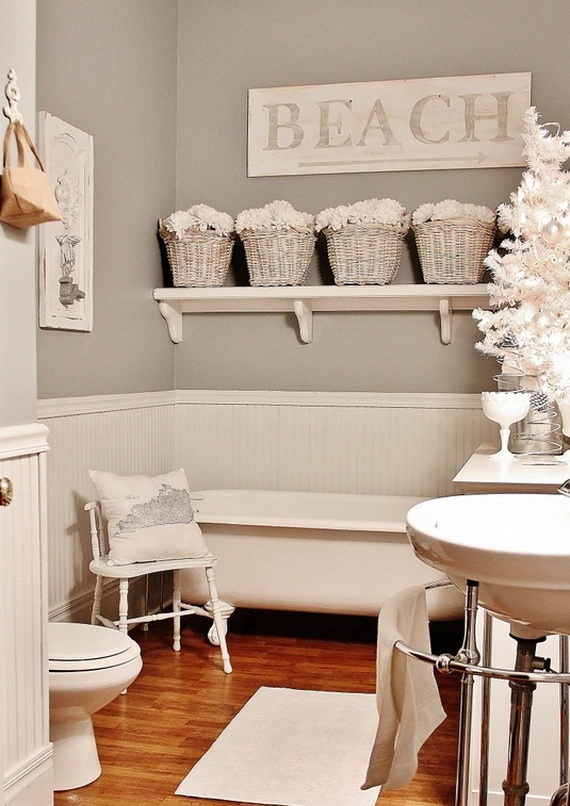 a single Christmas tree in white with lights and ornaments sticks to the decor theme and brings holiday vibes