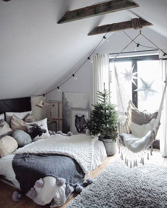 knit blankets with large tassels and a cozy faux fur rug make your bedroom welcoming and inviting