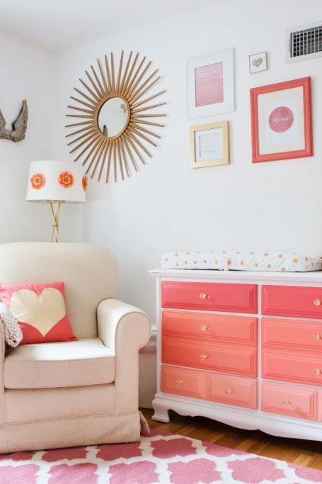 a bright ombre dresser from hot pink to light coral is a fun item for a girl's nursery