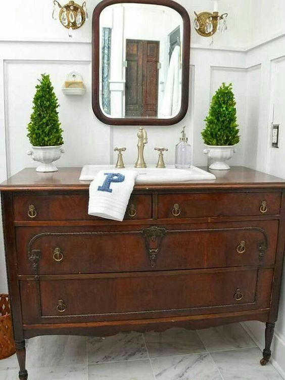 a couple of fake Christmas trees on both sides of the sink are great for a traditional bathroom