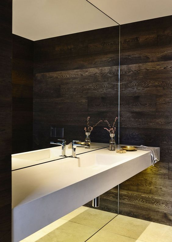 a whole mirror wall is a bold statement for a minimalist or modern bathroom, it will make the space look larger