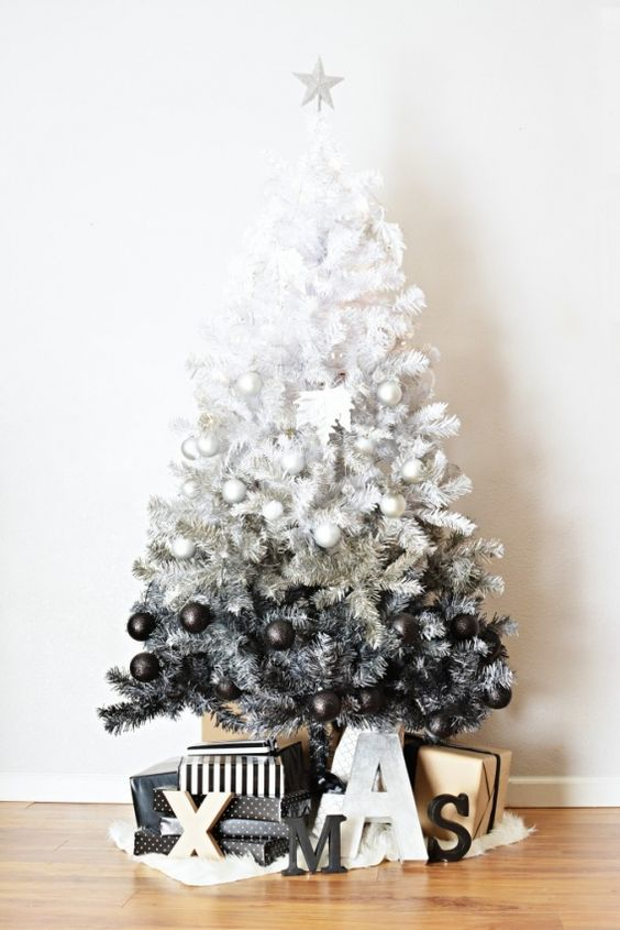 an ombre white to grey and black Christmas tree with ornaments of proper colors looks very modern and edgy