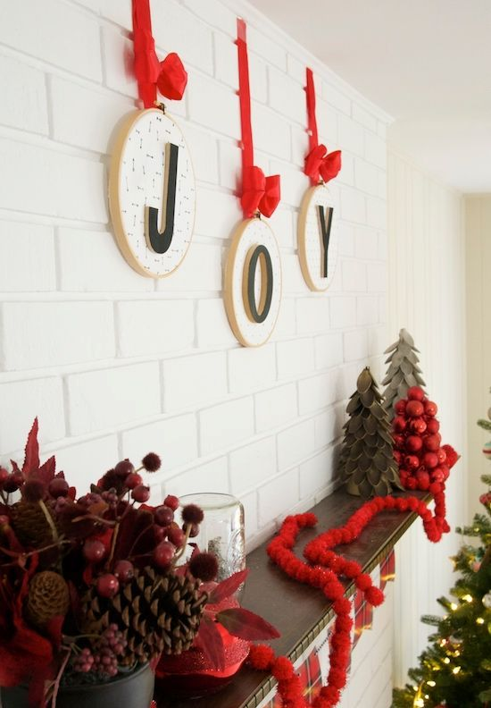 hoops with letters and red bows and ribbons are an amazing wall decoration for Christmas