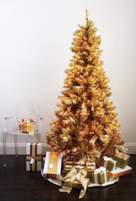 such a gold pre-lit Christmas tree doesn't require any special decor, it's beautiful and amazing itself
