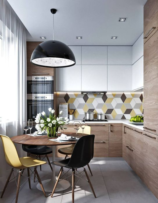 a modern and laconic kitchen accented with a colorful geometric backsplash