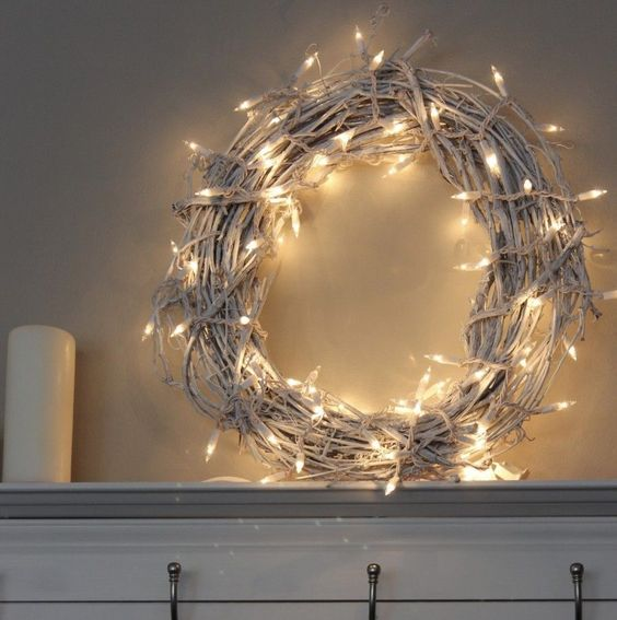 a white vine Christmas wreath with lights is a cool and simple DIY idea for holidays, it won't take much time to make