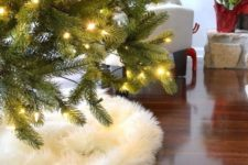 fur is a great way to cover a christmas tree base