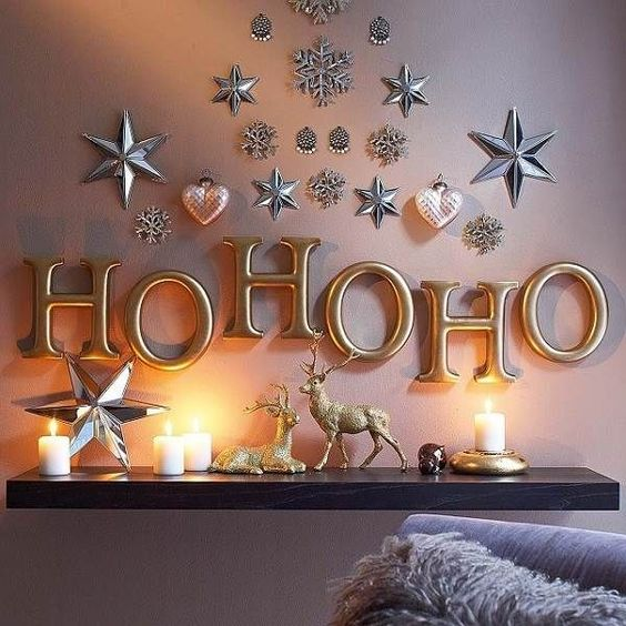 metallic letters and metallic hearts and stars attached right to the wall for holiday vibes