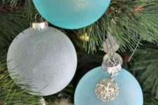 25 frosted blue and white Christmas ornaments with seashell charms are amazing for a coastal feel