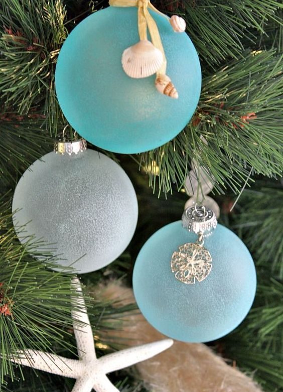 frosted blue and white Christmas ornaments with seashell charms are amazing for a coastal feel