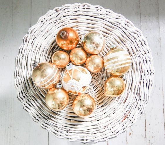 gold leaf Christmas ornaments can be displayed in baskets and bowls to make your decor special
