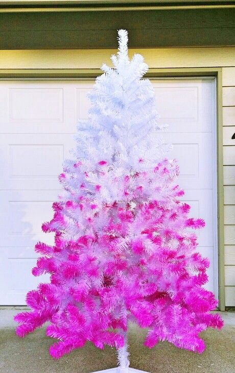 if you want to give your white Christmas tree a bold look, spray paint it pink with an ombre effect, it will look striking