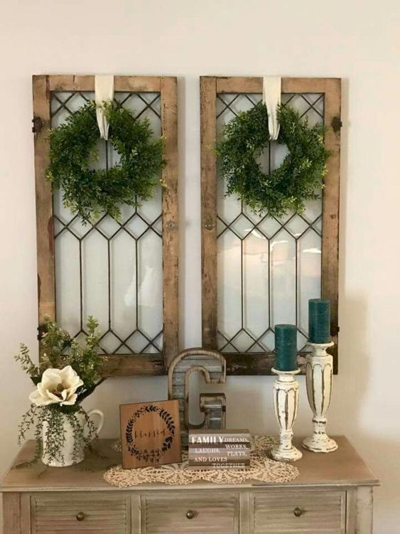 shabby chic windows with boxwood wreaths and ribbons hanging on them are amazing for Christmas