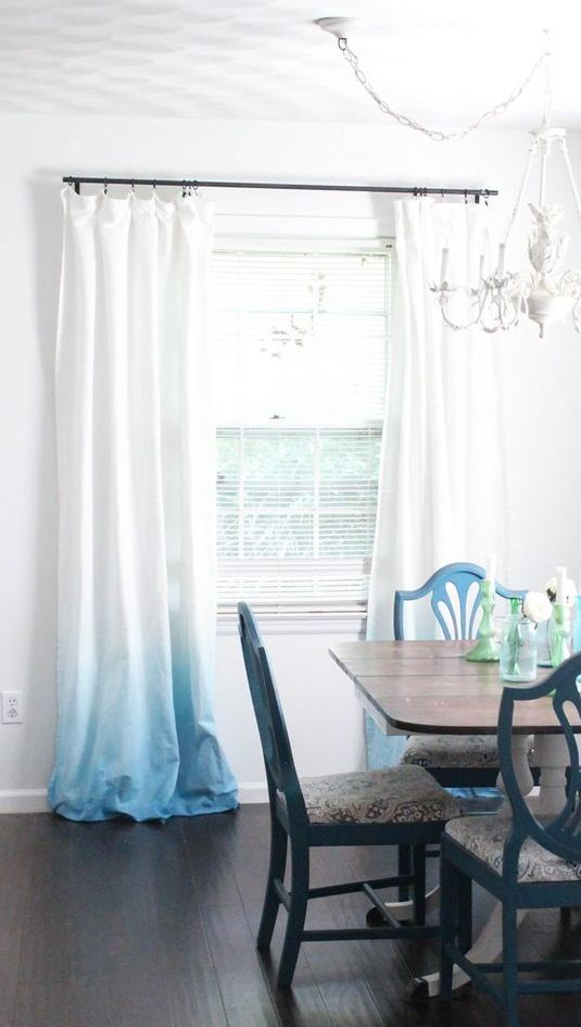 simple ombre curtains from white to light blue is a great idea for a beach or seaside interior and can be DIYed