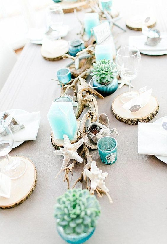 style your table with succulents in turquoise pots, turquoise candles and candle holders, star fish and driftwood