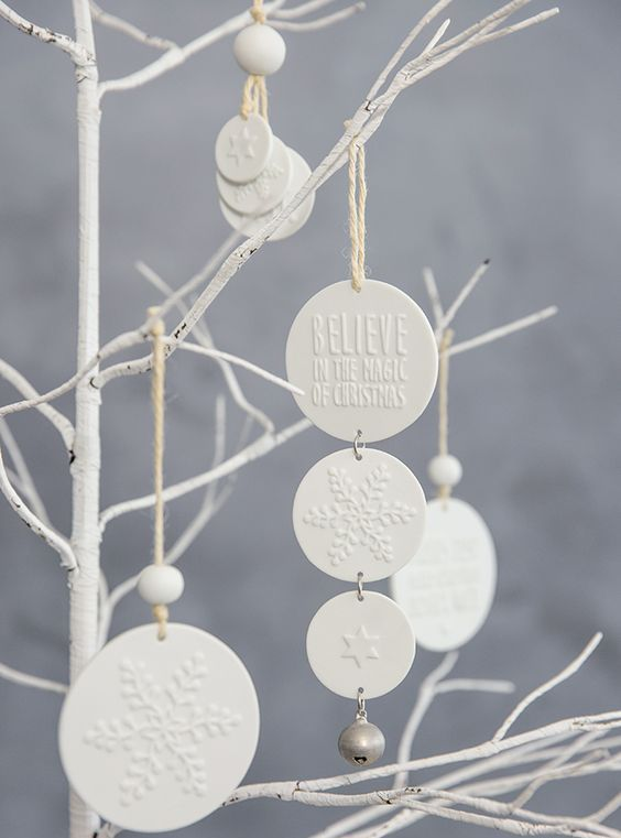 white clay Christmas ornaments with little jingle bells are a very cool decor and gift idea