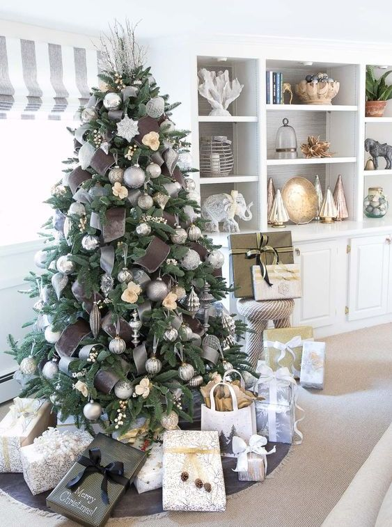 statement Christmas tree decor with silver grey ornaments, silver and chocolate brown ribbons plus snowflakes