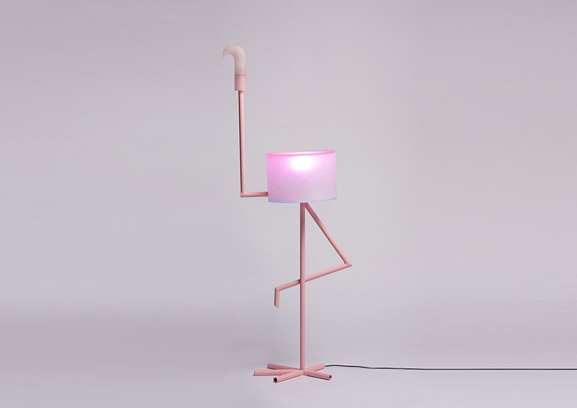 'I Am Cutie' is a fun and quirky lamp in pink and it features a flamingo standing on one leg