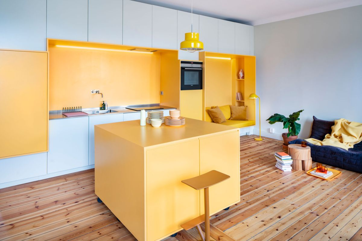 This contemporary apartment features sunny yellow as the main color as Sweden can't boast of much sunshine