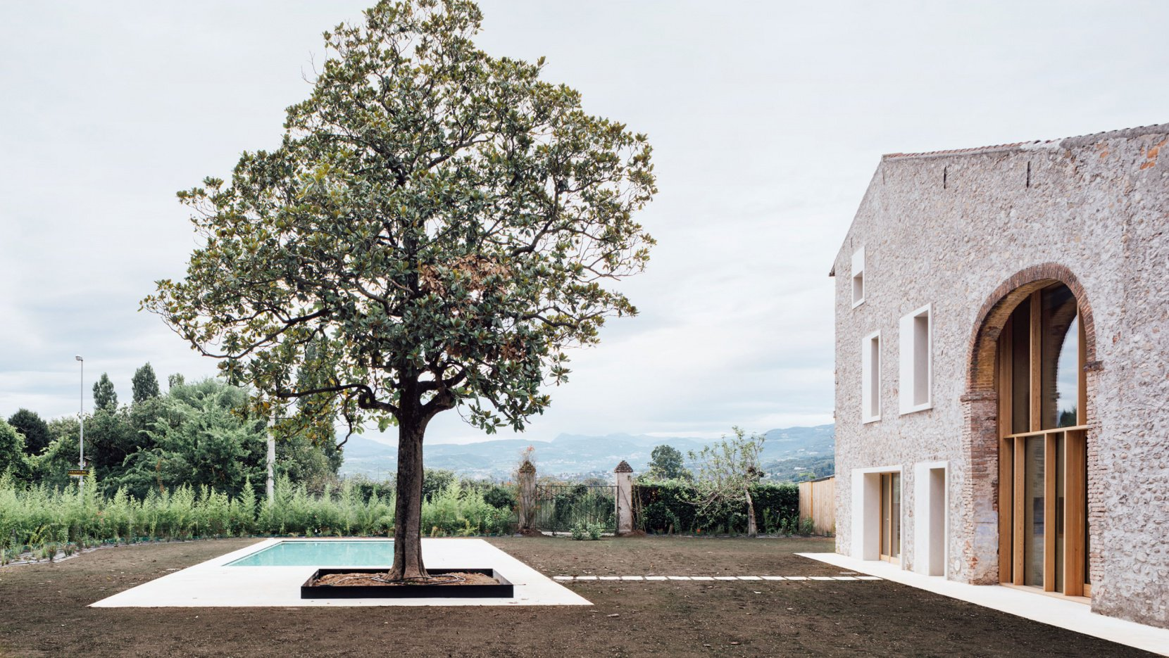 This contemporary family home is a converted stone barn in Italy, and it shows many sustainable features