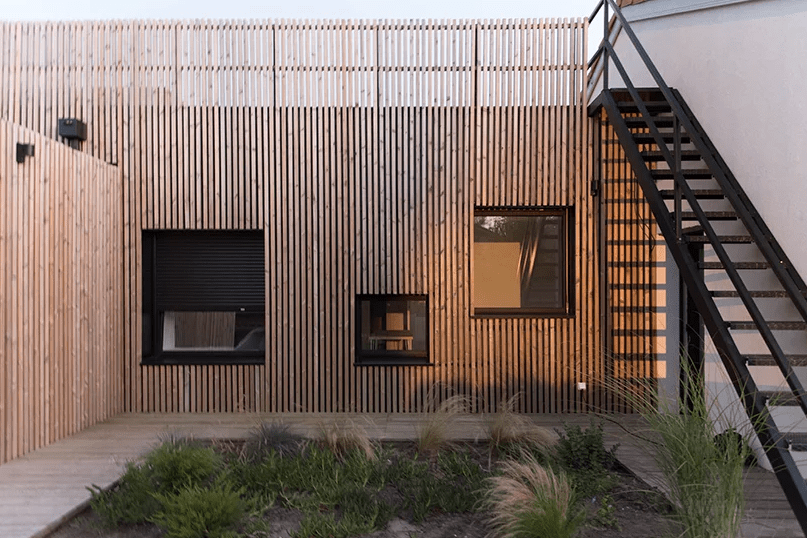 This house is located on the French seaside and is clad with pine slabs for a modern look