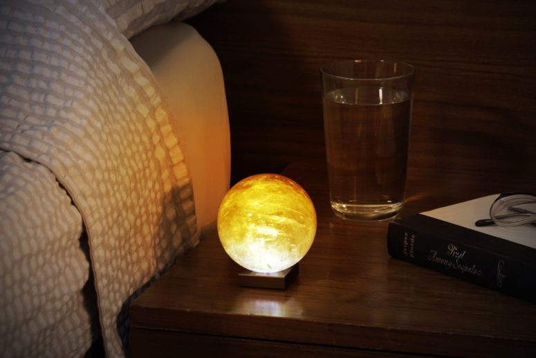 This lamp is called Solar Sun Mood lamp and is made of golden calcite, a unique crystalline structure with a translucent appearance that has a softness and warmth like no other