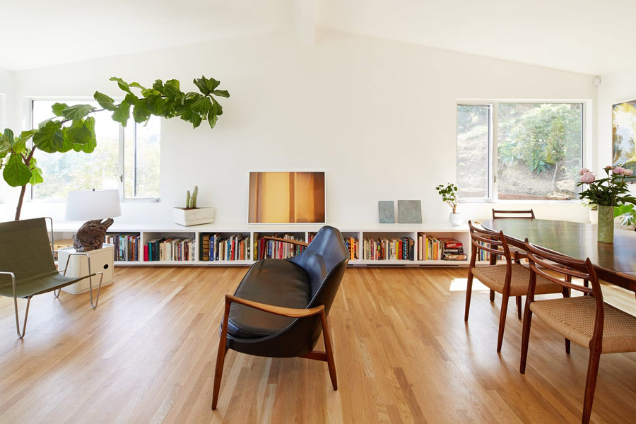 This mid century modern home features spaces that seamlessly flow one into another and lots of natural light
