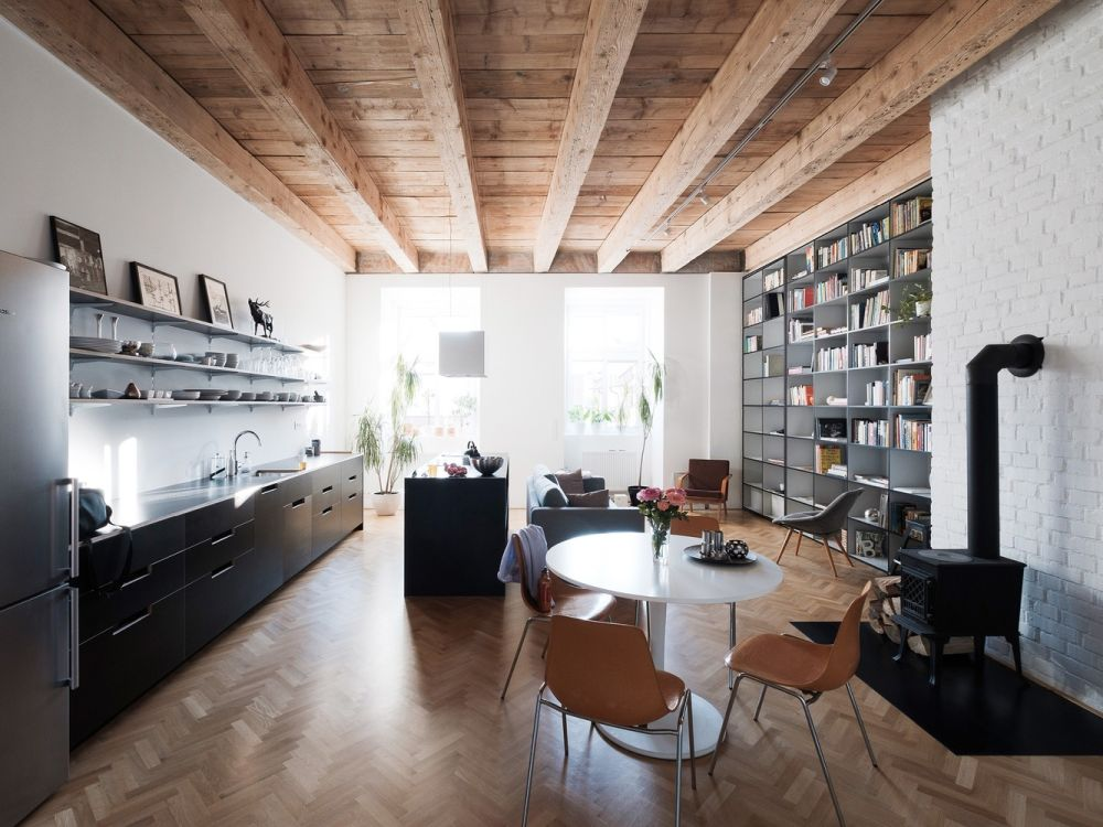 This ultra modern apartment is located in a former monastery and features a functional interior and practical solutions