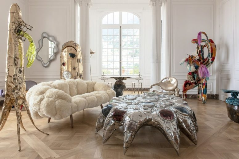 This unique coffee table wows, it's a gorgeous design with large rhinestones that is inspired by a sea creature