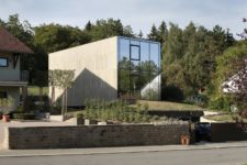 01 This unusual and monolith looking house features minimalist and even brutalist aesthetic