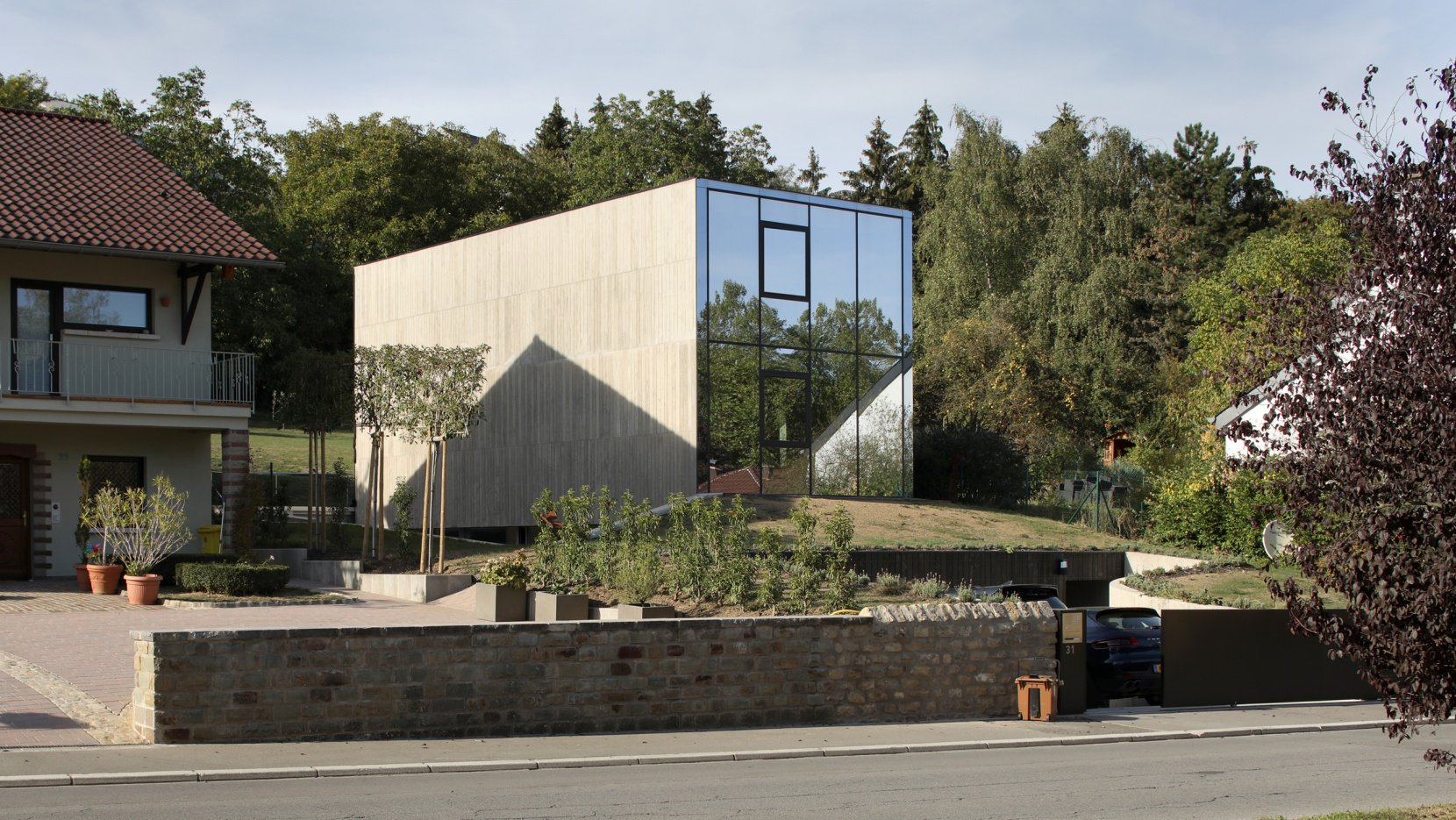 This unusual and monolith looking house features minimalist and even brutalist aesthetic