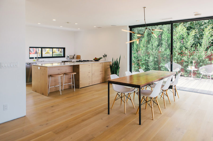 This welcoming and inviting family home was renovated by the owner himself for his family and features stylish minimalism and lots of natural light