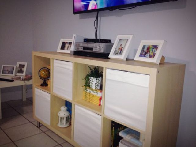 IKEA Kallax shelving unit with Drona boxes for a cheap TV stand