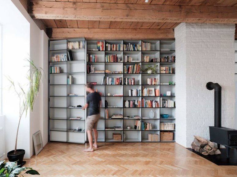 The door to the bedroom is hidden inside the bookcase, which is a smart idea to rock