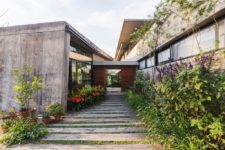 02 The home features chic landscaping and some outdoor zones