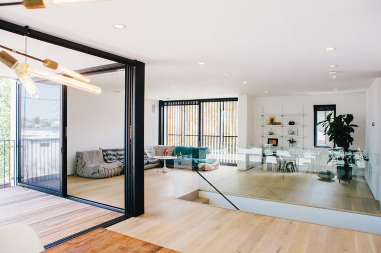 The spaces seamlessly flow into each other and glazed walls allow amazing views and much light