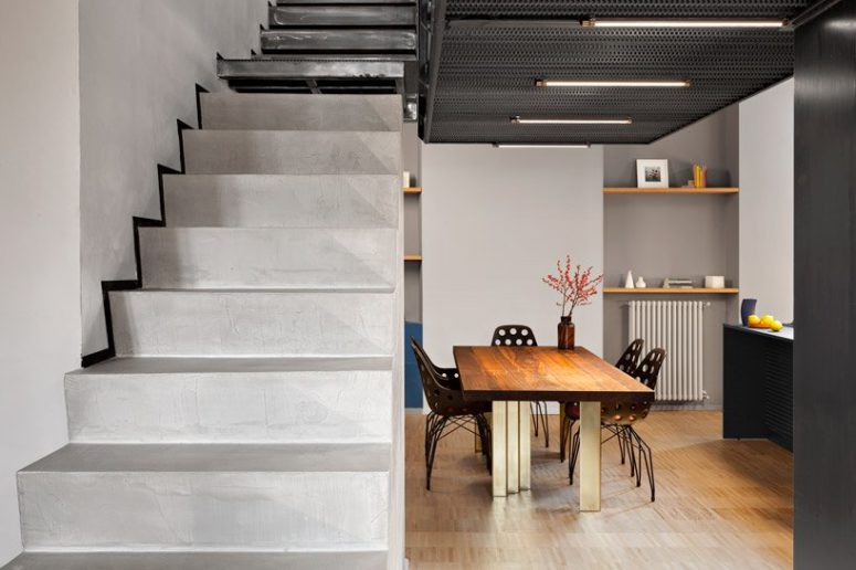 The staircase is made of concrete, too, and it connects the two levels of the apartment