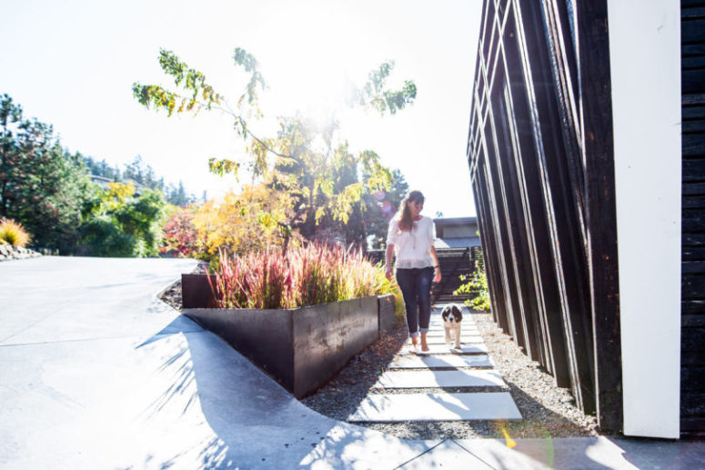 You may see perfectly styled landscaping, gravel and tile pathways and bold grasses to acaent the house