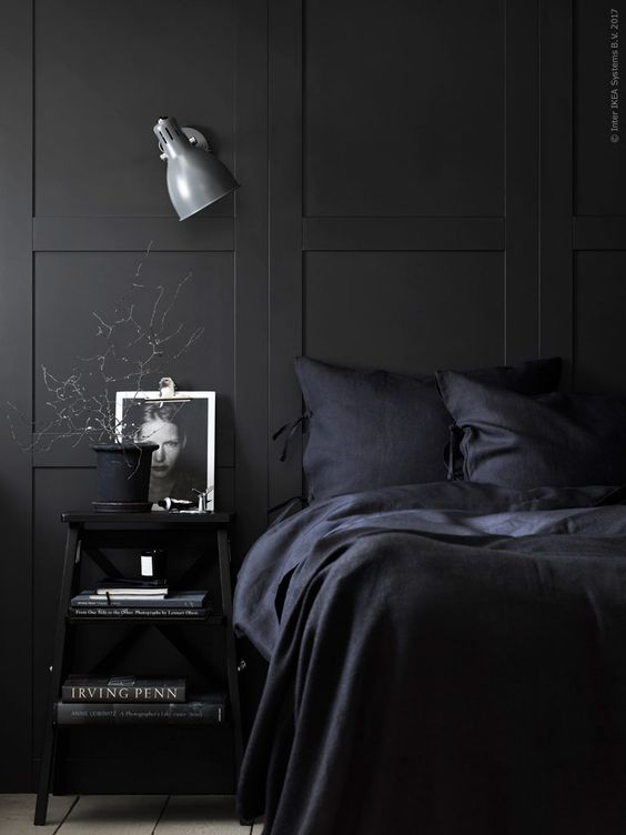 a moody bedroom with black bedding is a comfortable sleeping oasis for any winter