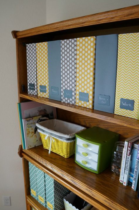 a stylish and comfortable family filing system with colorful printed files and chalkboard tags