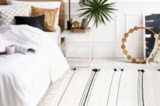 02 a welcoming and relaxed bedroom with layered neutrals and touches of black for some drama and depth